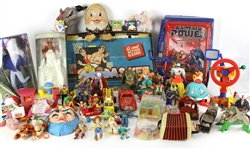 1930s-2000s Toys and Board Games Including Eddie Cantor's Tell It To The Judge Board Game, GI Joe Figurine, Barbie Figurine, McDonalds Happy Meal Toys and More.